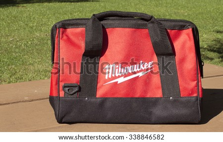 RIVER FALLS,WISCONSIN-NOVEMBER 12,2015: A Milwaukee brand tool bag sitting on a wooden bench. - stock photo