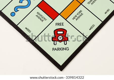 RIVER FALLS,WISCONSIN-NOVEMBER 16,2015: A Monopoly board featuring the Free Parking square. Monopoly originated in the United States in Nineteen Hundred and Three. - stock photo