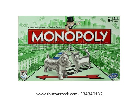 RIVER FALLS,WISCONSIN-NOVEMBER 01,2015: A Monopoly game box by Hasbro. Monopoly is a board game that originated in the United States in Nineteen Hundred and Three. - stock photo