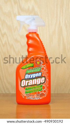 RIVER FALLS,WISCONSIN-SEPTEMBER 29,2016: A bottle of Oxygen Orange cleaner with a wood background.