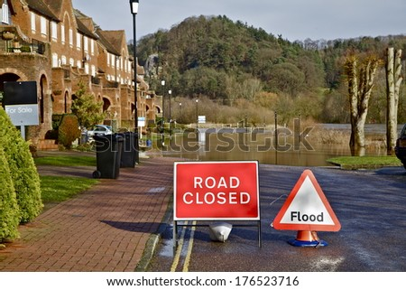 River Flooding road. - stock photo