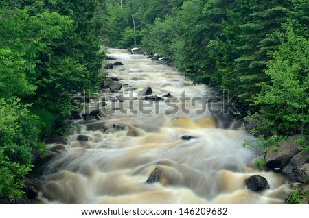 River Flowing Through the Forest in Northern Minnesota, East Branch of the Baptism River - stock photo