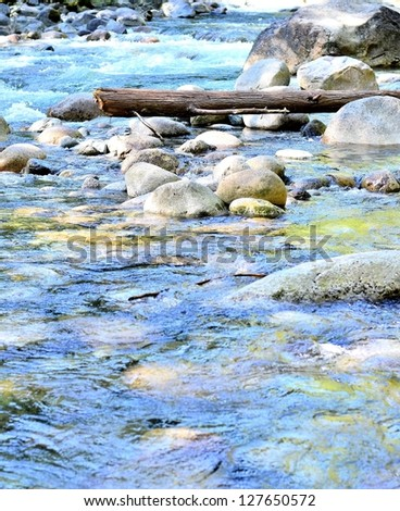 River flows down in the forest - stock photo