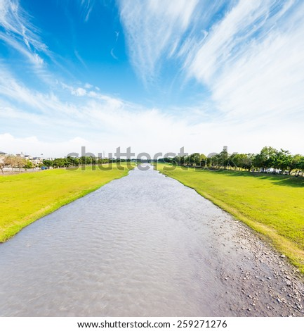River flows green meadow land under sunny day, Dong Shan River, Yilan City, Taiwan  - stock photo