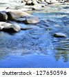 River flows in the forest - stock photo