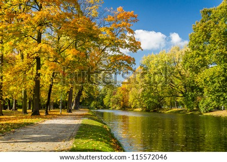 River in autumn park on a sunny day - stock photo