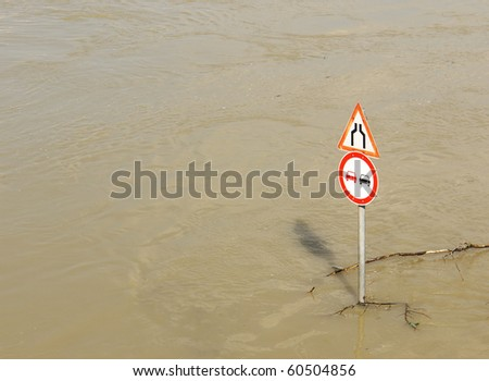 River in flood with traffic sign - stock photo