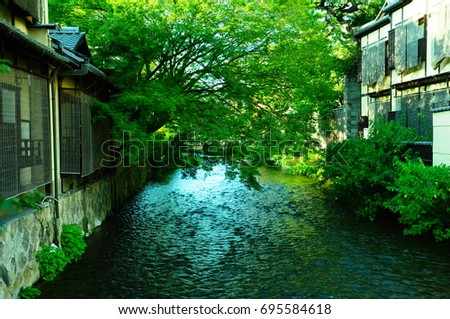 https://thumb9.shutterstock.com/display_pic_with_logo/167494286/695584618/stock-photo-river-in-kyoto-695584618.jpg