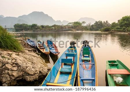 River in Laos.Vang Vieng Landscape.Boat park at riverside. - stock photo