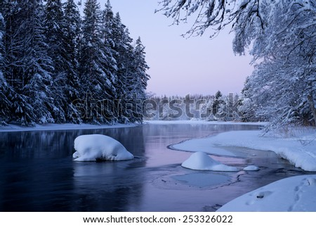 River in winter and tree covered with white snow in sunrise - stock photo