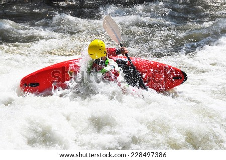 River Kayaking as extreme and fun sport, eskimo roll - stock photo