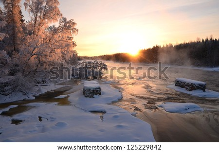 River landscape in a very cold morning at sunrise - stock photo