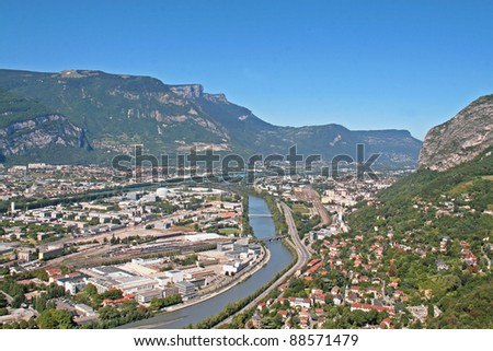 River passing through Grenoble with Alps in background