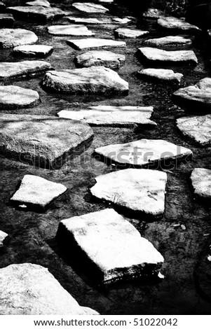 River pathway in monochrome - stock photo