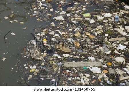 River pollution - stock photo