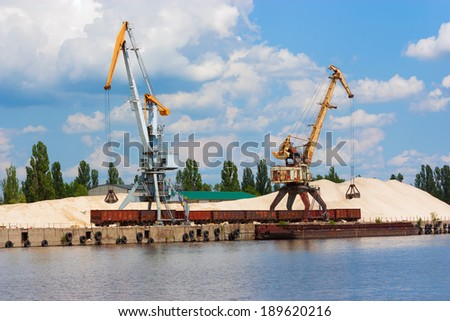 River port, a jetty for the shipment of sand - stock photo