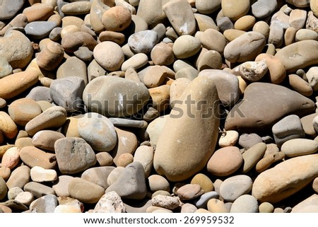 River rock pebbles with shades of different gray. - stock photo