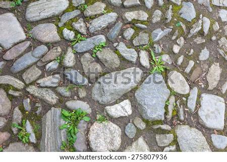 River rough stones pavement background - stock photo