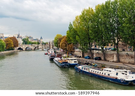 river seine in paris on a cloudy day  - stock photo