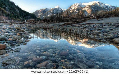 River side pool contains perfect mountain reflect. - stock photo