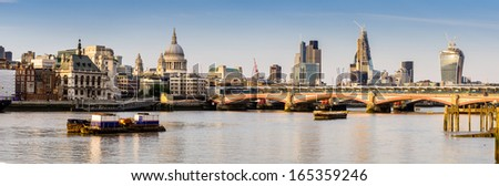 River Thames in London, the view to the north shore and the Cathedral of St. Paul - stock photo