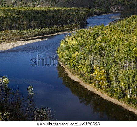 river through the forest in the northeast of china - stock photo