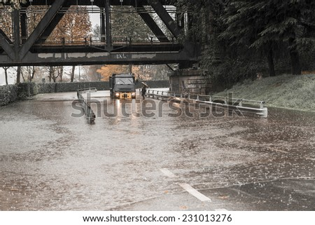 River Ticino overflow in street of Sesto Calende and trucks on flooded road, Varese - stock photo