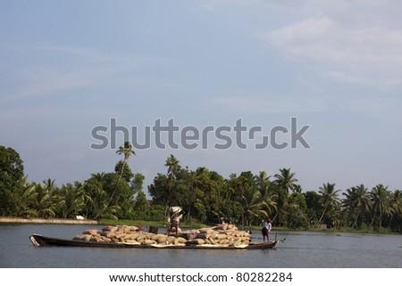 River transport of goods, Kerela Backwaters - stock photo