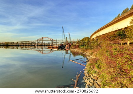 river transportation ways at sunrise, with skytrain railway, train railway, highway and a port - stock photo