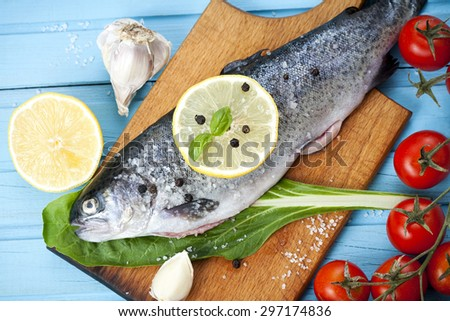River trout with fresh tomatoes, lemon and herbs - stock photo