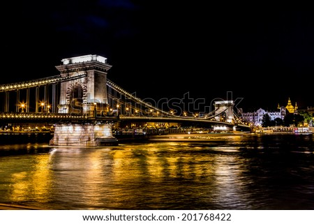 River view of Budapest at evening, illuminated Chain Bridge and Parliament Building. - stock photo