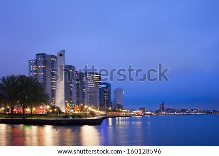 River view of Rotterdam city center at night in Netherlands, South Holland province. - stock photo