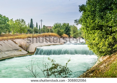 River waters flowing in the Italian countryside at the sunset
