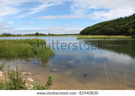 river with many whirlpools within  at high tide - stock photo