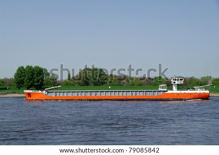 Riverboat with oil - stock photo