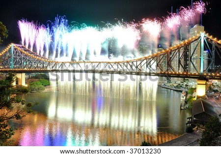 Riverfire waterfall and rainbow in Brisbane - stock photo