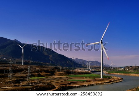 Rivers, mountains and the wind turbine to generate electricity