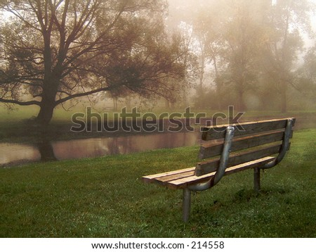 Riverside Bench in Fog - stock photo