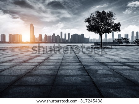 Riverside cityscape, clouds and sunshine exist, urban fantasy landscape, exaggerated expression. - stock photo