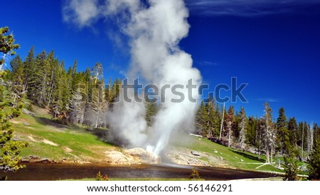 Riverside Geyser, Old Faithful Basin, Yellowstone National Park - stock photo
