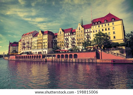 Riverside with old houses in East Center of Berlin, toned image - stock photo