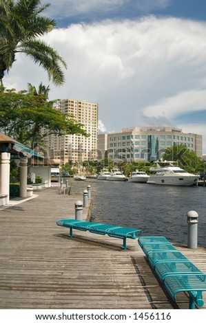 Riverwalk Park and benches along New River in Los Alos, Ft. Lauderdale, Florida - stock photo