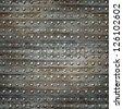 riveted metal garage door wall ; grunge industrial background - stock photo