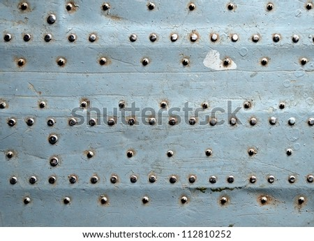 Riveted metal texture - stock photo