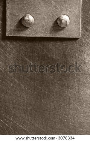 riveted seam on the metal scratched sheet - stock photo