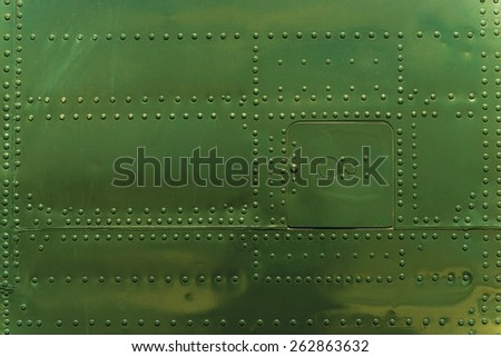 Rivets and Metal Background Dark Green Painted. Metal Military Grade Backdrop - stock photo