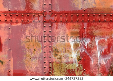 Rivets rust and weathered paint on an old caboose - stock photo