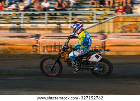 Rivne, Ukraine - 29 August 2015: Unknown rider overcomes the track at the Open Cup Speedway to the day of the city Rivne - stock photo