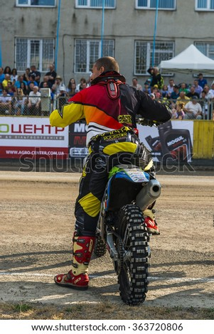 Rivne, Ukraine - 11 October 2015: Unknown rider  during a prepare for the race at the Open Cup Speedway to the day of the city Rivne - stock photo