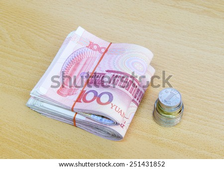 RMB Chinese with coin on the table - stock photo
